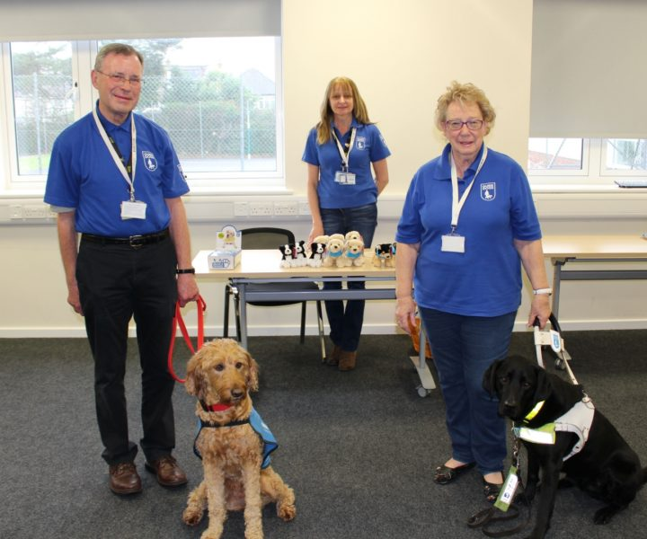 Guide Dogs representatives with two dogs