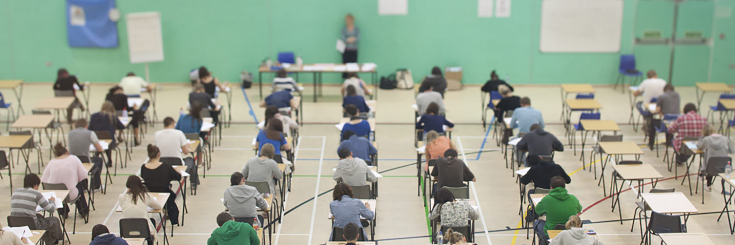 Students taking exams in the sports hall