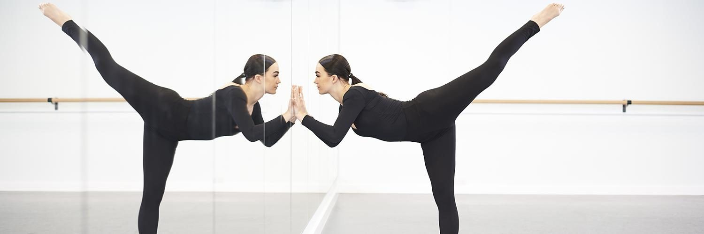 Dance student in mirror