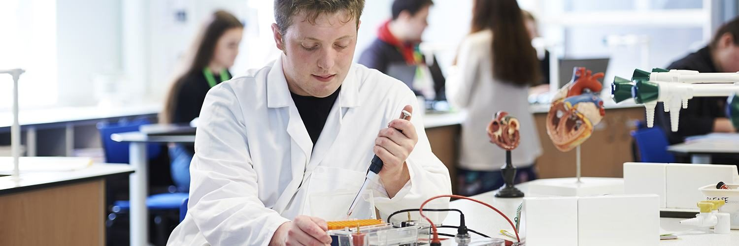 Student performing science experiment