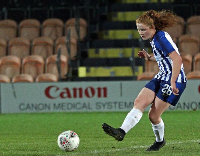 Libby Bance kicking a football