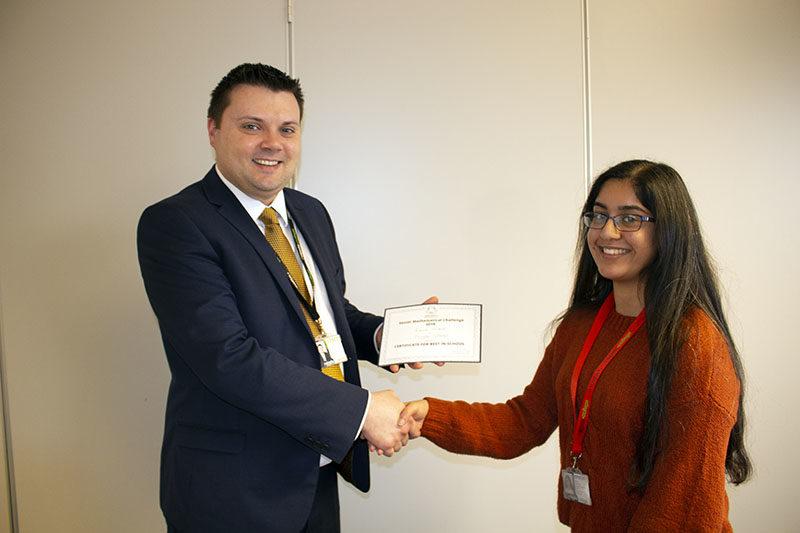 Principal presenting award to student